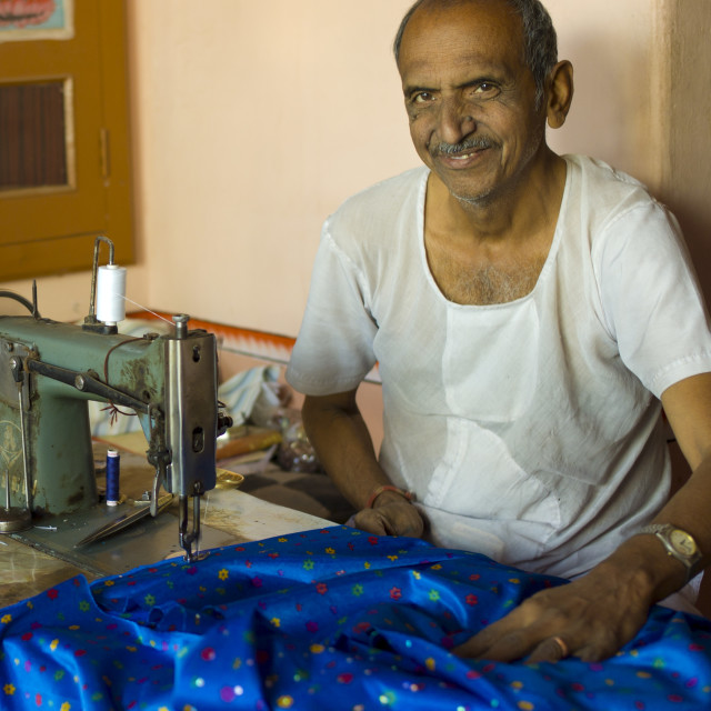 """Indian man with traditional sewing machine making sari in Rajasthani..."" stock image"