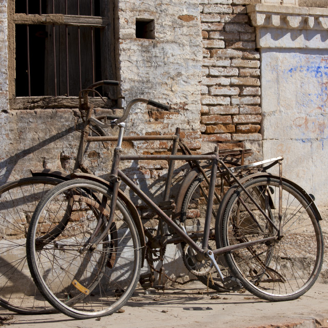 """Bicycles propped on old building in Narlai village in Rajasthan, Northern India"" stock image"
