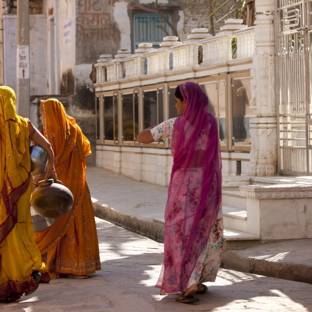 """""""Rajasthani women carrying water pots in the village of Narlai in Rajasthan,..."""" stock image"""