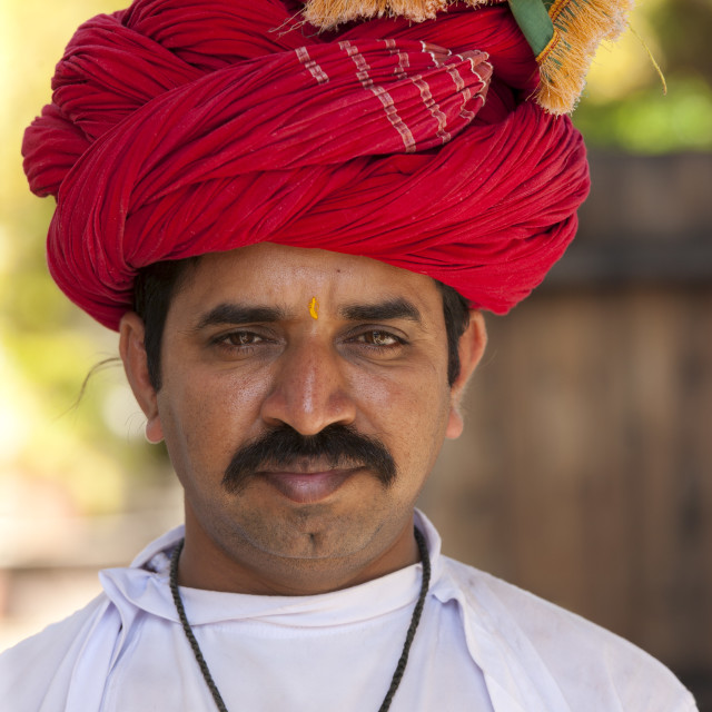 """""""Young Indian man with traditional Rajasthani turban in Narlai village in..."""" stock image"""