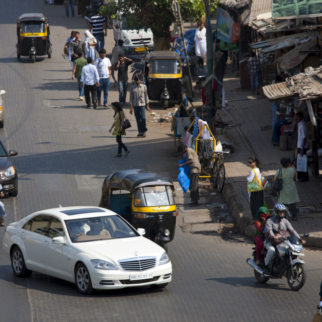 """Mercedes S Class luxury saloon and auto rickshaws among traffic in Bandra..."" stock image"