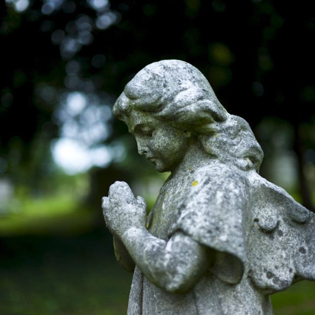 """Statue of an angel in the graveyard of St Mary the Virgin Church in..."" stock image"