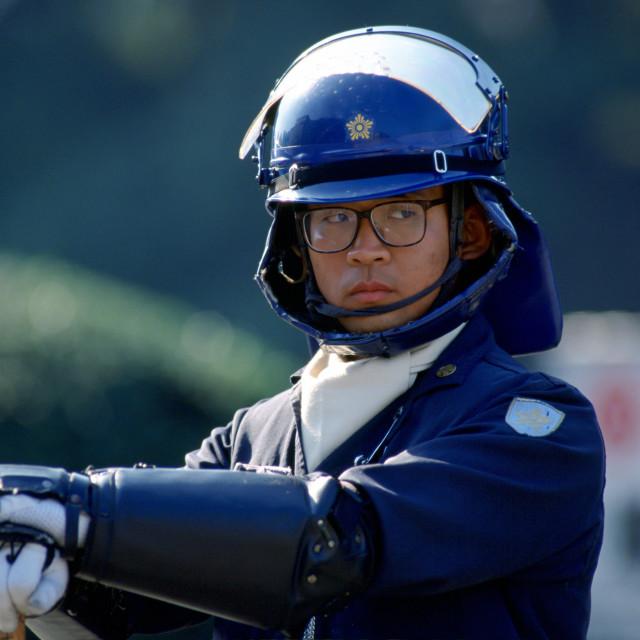"""Police officer in Tokyo, Japan"" stock image"
