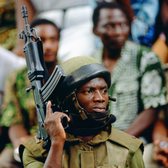 """Soldier with machine gun in Cameroon, West Africa"" stock image"