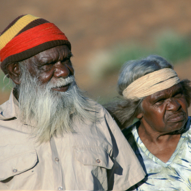 """""""Aborigines at Ayers Rock in the Northern Territory in Australia"""" stock image"""