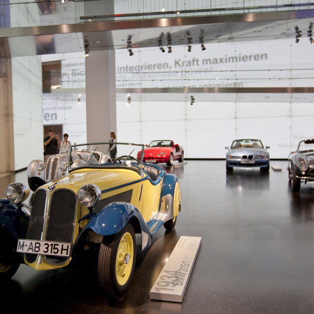 """Visitor at BMW Museum views BMW 315 1934 model car on display at the BMW..."" stock image"