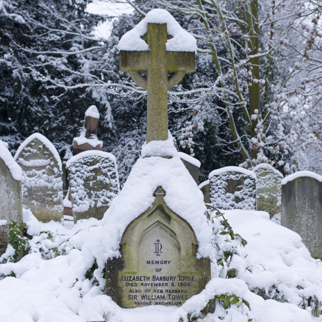 """Snow-covered gravestones in Hampstead Parish Graveyard in Church Row and..."" stock image"