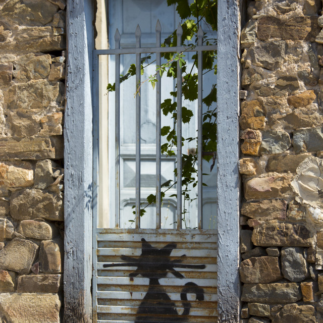 """""""Cat drawn on gate at Potes in Picos de Europa, Asturias, Northern Spain"""" stock image"""