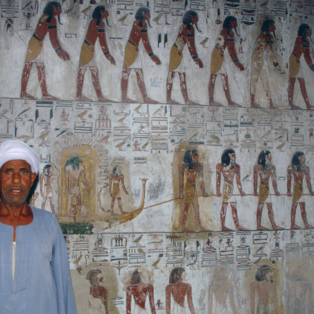 """""""Egyptian man standing guard in King Seti's tomb in the Valley of the Kings,..."""" stock image"""