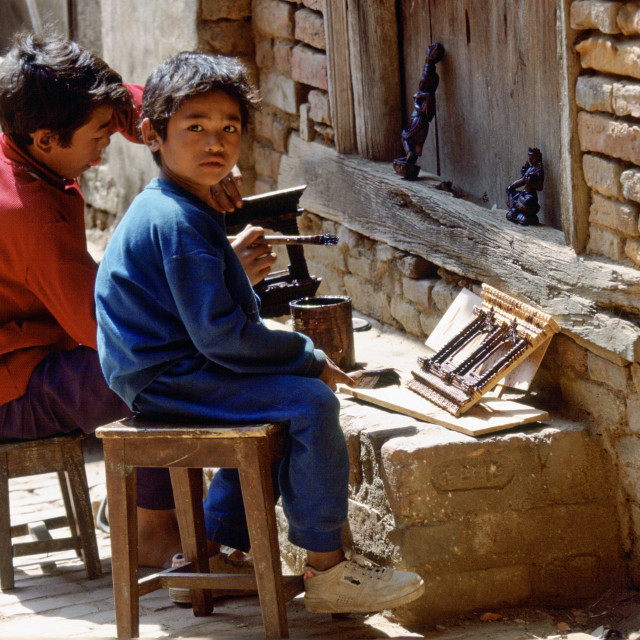 """""""Young child workers painting carvings, Bhaktapur, Nepal"""" stock image"""