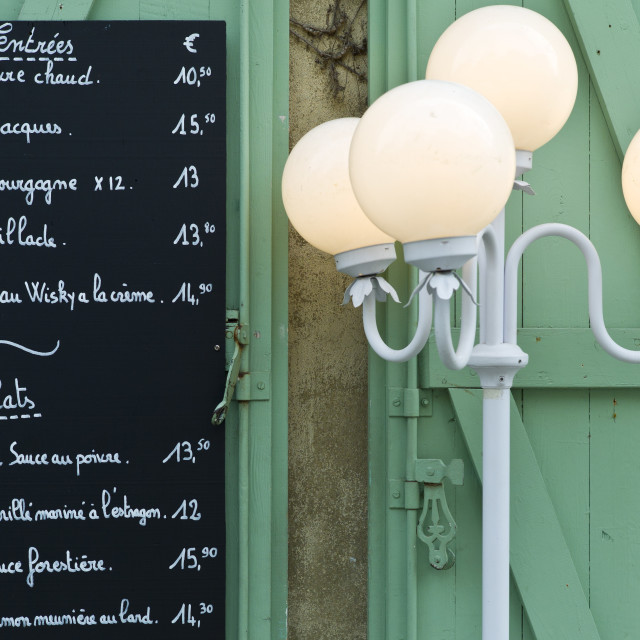 """Traditional French Cafe menu of Entrees and Plats in quaint town of..."" stock image"