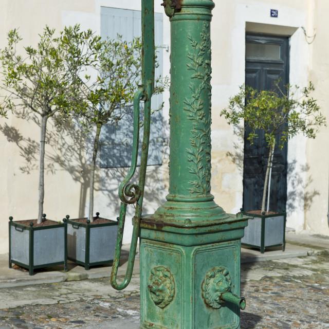 """""""Old village water pump at St Martin de Re, Ile de Re, France"""" stock image"""