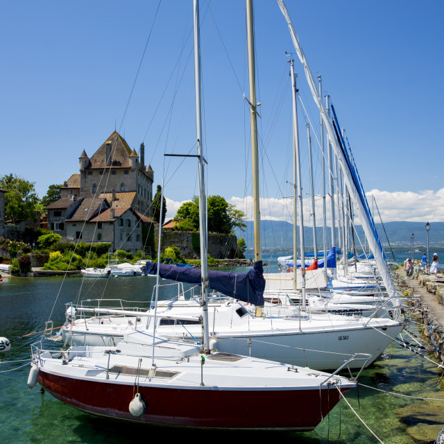 """""""Yachts by the 12th century medieval castle in the old port of Yvoire on Lac..."""" stock image"""