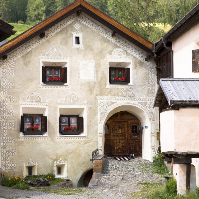 """House in the Engadine Valley in the village of Guarda with old painted stone..."" stock image"