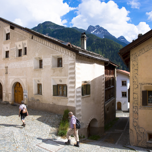 """Tourists stroll in the Engadine Valley in village of Ardez with restored..."" stock image"