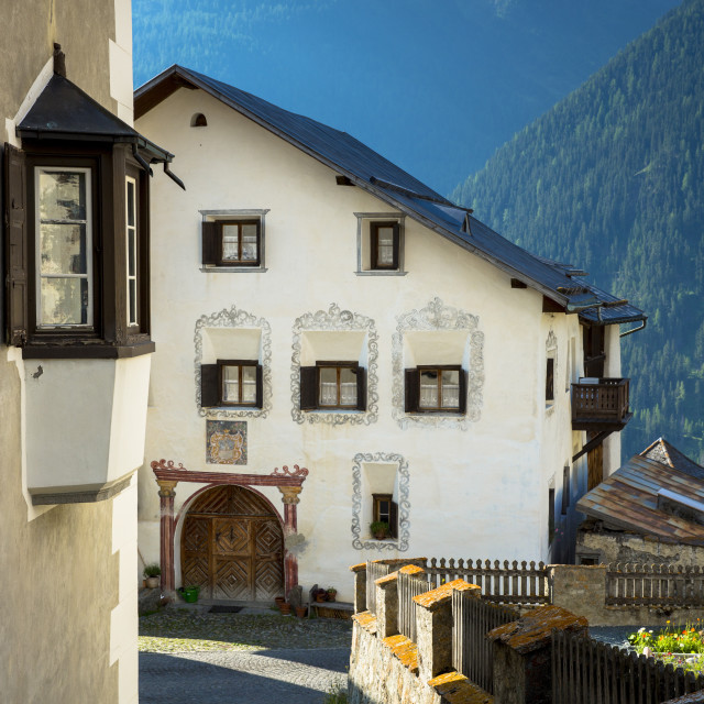 """Old painted stone 17th century buildings in the village of Guarda, Engadine..."" stock image"