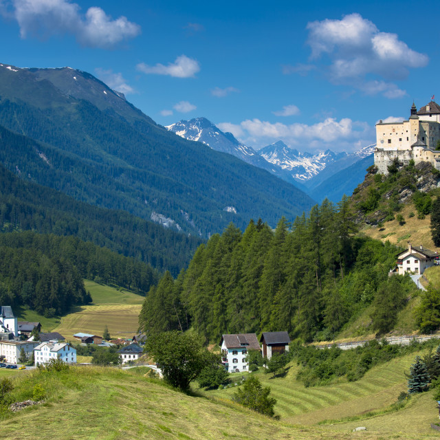 """Tarasp Castle and Fontana village surrounded by larch forest in the Lower..."" stock image"