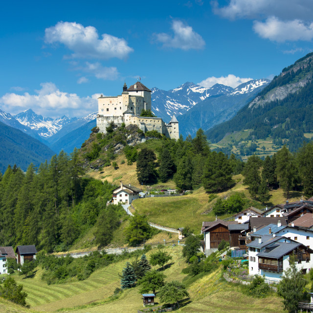 """Tarasp Castle surrounded by larch and pine forest in the Lower Engadine..."" stock image"