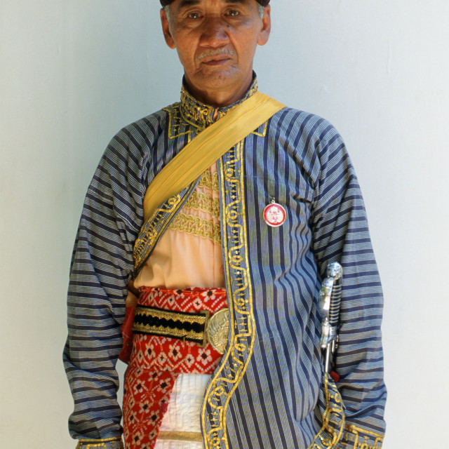 """Man in ceremonial dress at Sultan's Palace, Yogyakarta, Indonesia"" stock image"