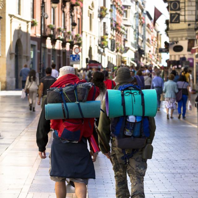 """Pilgrims travelling on Camino Santiago reach Calle Ancha in Leon, Castilla y..."" stock image"