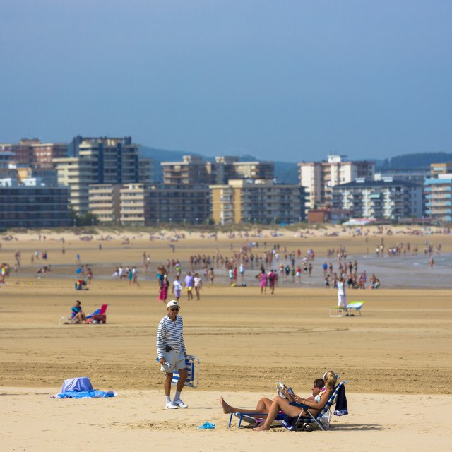"""Beach scene and people sunbathing on summer holiday in Laredo, Cantabria,..."" stock image"