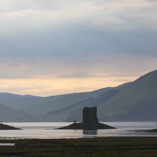"""""""Stalker Castle, a highland fortress, on Loch Linnhe at sunset near Strontian,..."""" stock image"""
