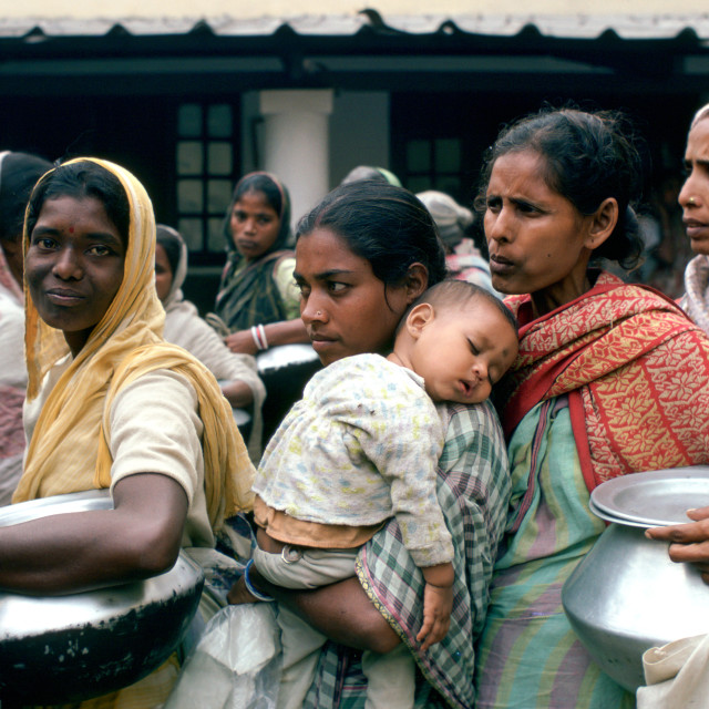 """Poor women queuing for food at Mother Teresa's Mission in Calcutta, India"" stock image"