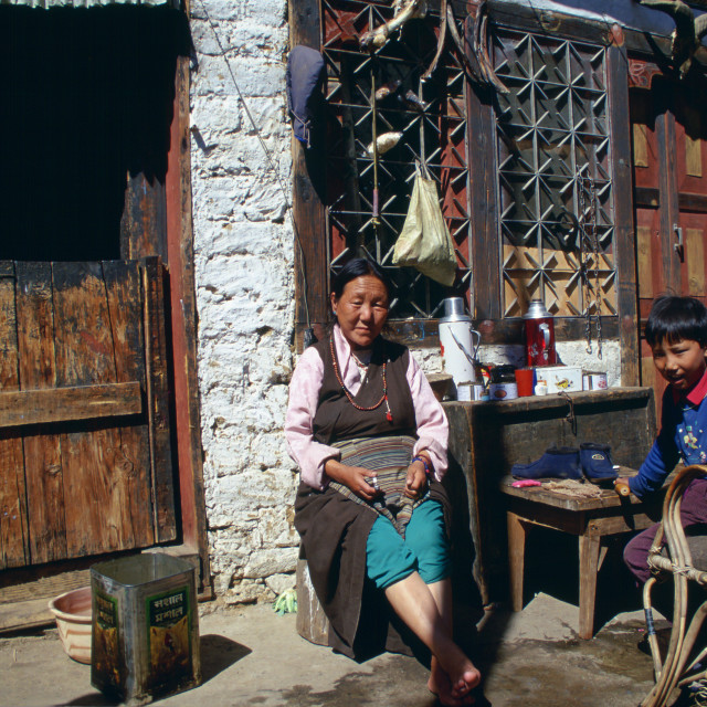 """Woman and children at home in Paro, Bhutan"" stock image"
