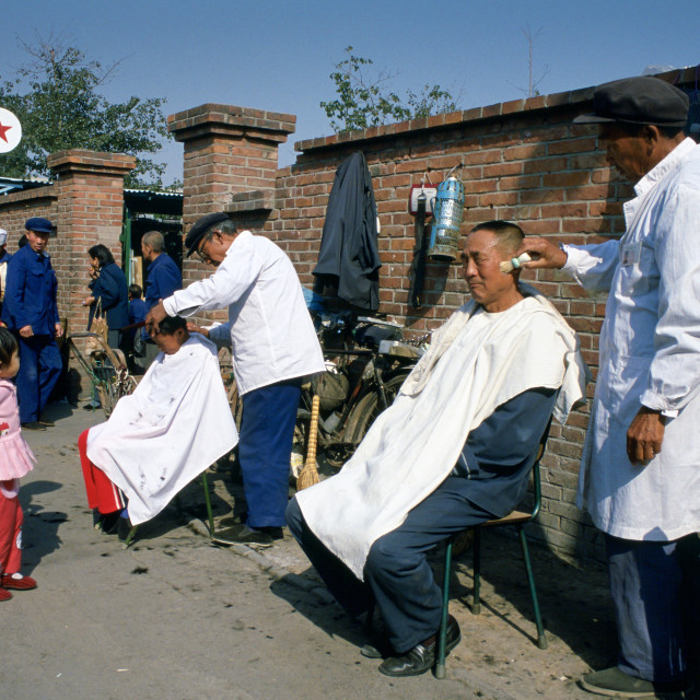 """Men at work at an outdoor Barbers' Shop in Old Peking (Beijing), China. One..."" stock image"