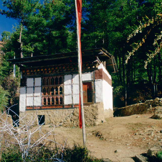 """Farmer's home with prayer flags, Bhutan"" stock image"