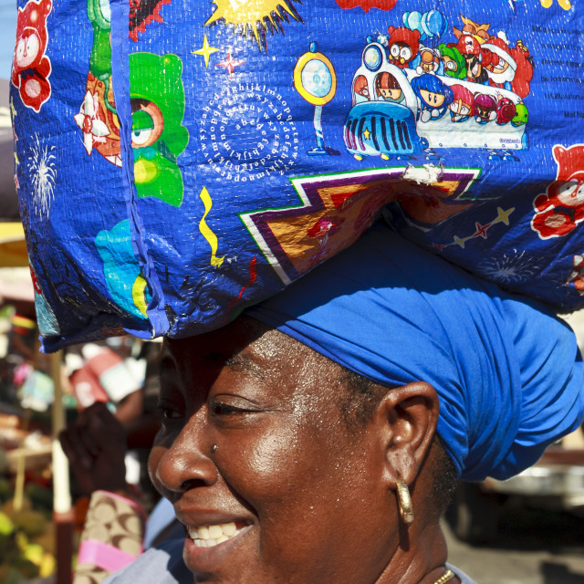 """""""Lady with shopping bag on head, market, Roseau, Dominica, West Indies,..."""" stock image"""
