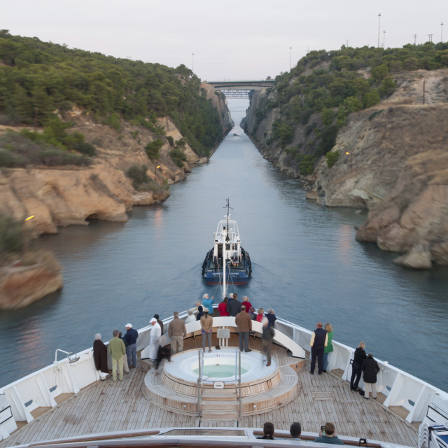 """""""Tourists on the bow of a small cruise ship being pulled by a tug, early..."""" stock image"""