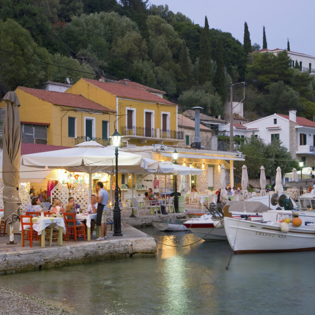 """Typical waterfront taverna illuminated at dusk, Kioni, Ithaca (Ithaki),..."" stock image"