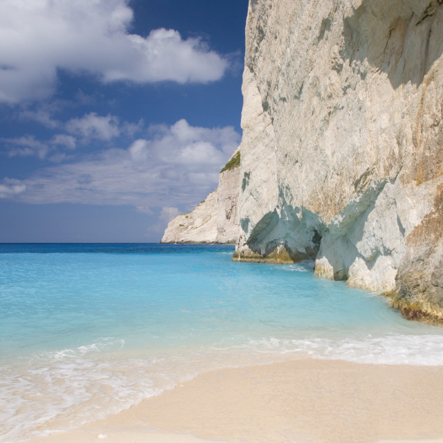 """Limestone cliffs towering above turquoise sea, Navagio Bay, Anafonitria,..."" stock image"