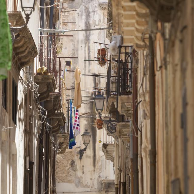 """Back streets, balconies, Ortigia"" stock image"