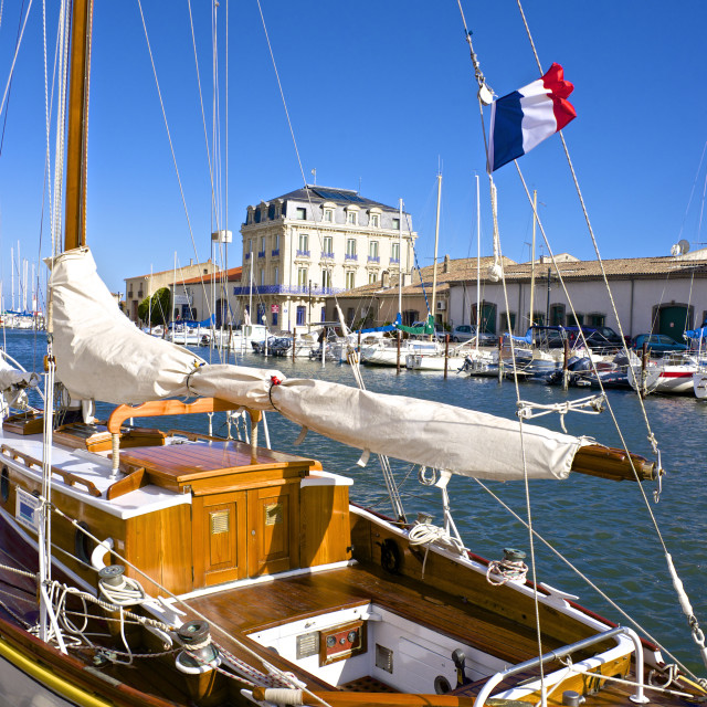"""""""Tourist boats in marina, and French flag, in Marseillan harbor, Herault,..."""" stock image"""