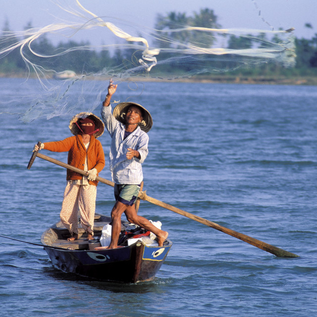 """Fisherman casting net, Hoi Han, Vietnam, Indochina, Southeast Asia, Asia"" stock image"