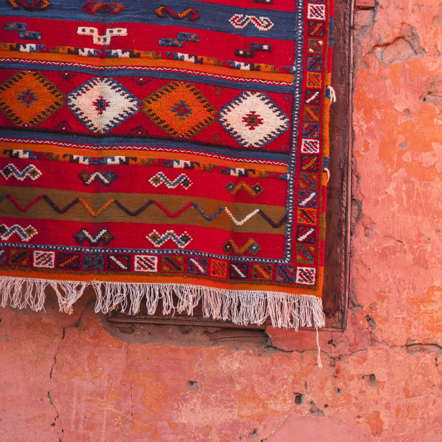 """""""Carpet hanging on red wall, Marrakech, Morocco, North Africa, Africa"""" stock image"""