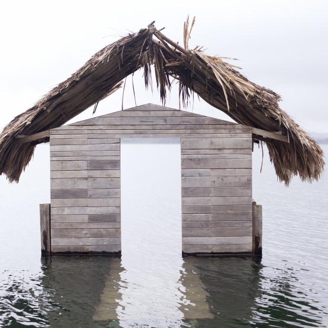 """High water floods lakeside cabanas, Climate Change, Lago Peten Itza,..."" stock image"