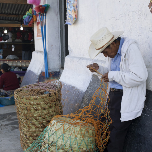 """Man mending basket, Nebaj, Guatemala, Central America"" stock image"