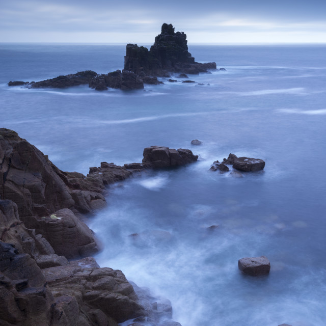 """Twilight view from Land's End cliffs towards The Armed Knight island,..."" stock image"
