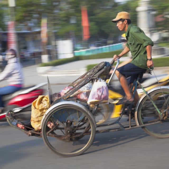 """Man riding cyclo, Hue, Thua Thien-Hue, Vietnam, Indochina, Southeast Asia, Asia"" stock image"
