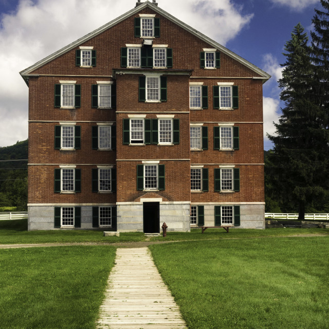 """""""1830s brick building used as housing for about 100 members of the Shaker..."""" stock image"""