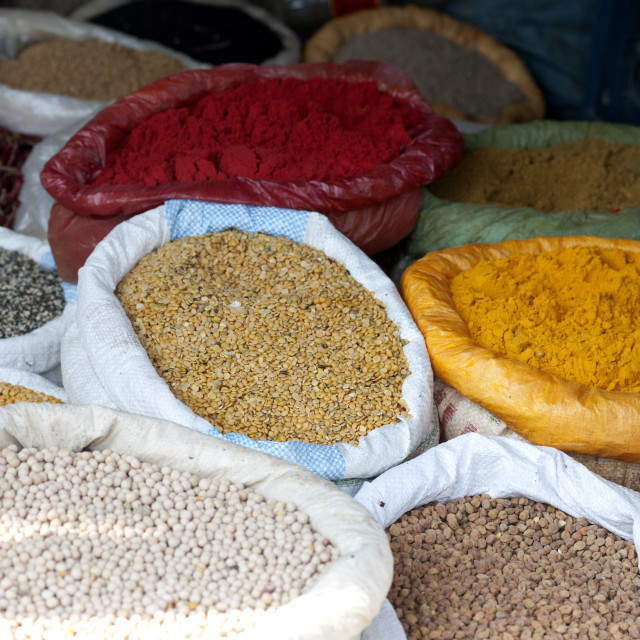"""Pulses and spices in sacks for sale in Tizit village weekly local market,..."" stock image"