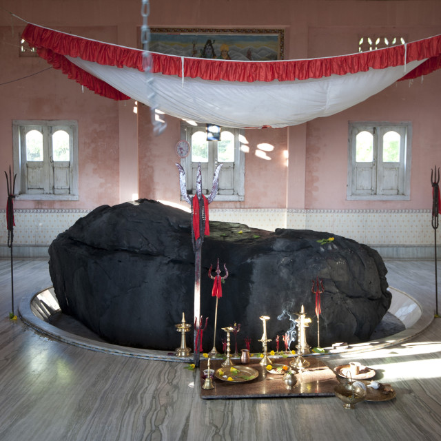 """""""Holy rock from the Brahmaputra, painted black, in the centre of village Shiva..."""" stock image"""