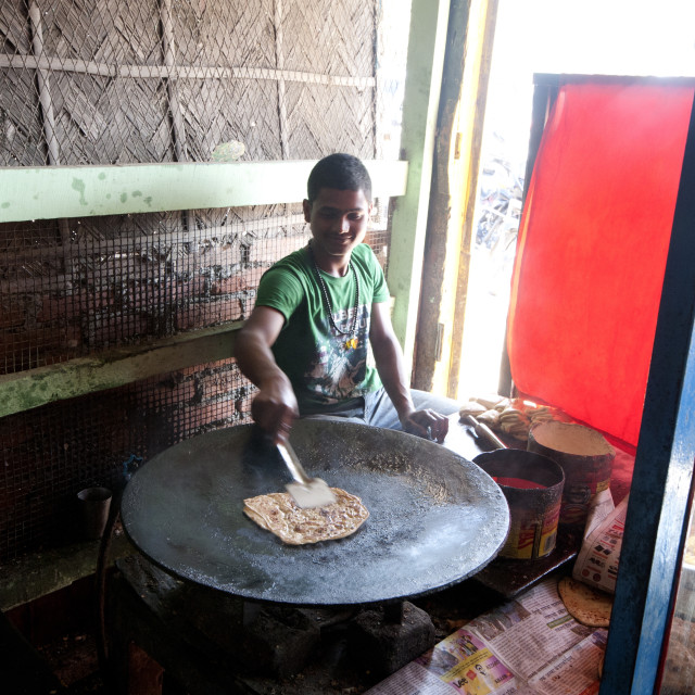 """""""Young man cooking chapati in roadside dhaba, Balipara, Assam, India, Asia"""" stock image"""