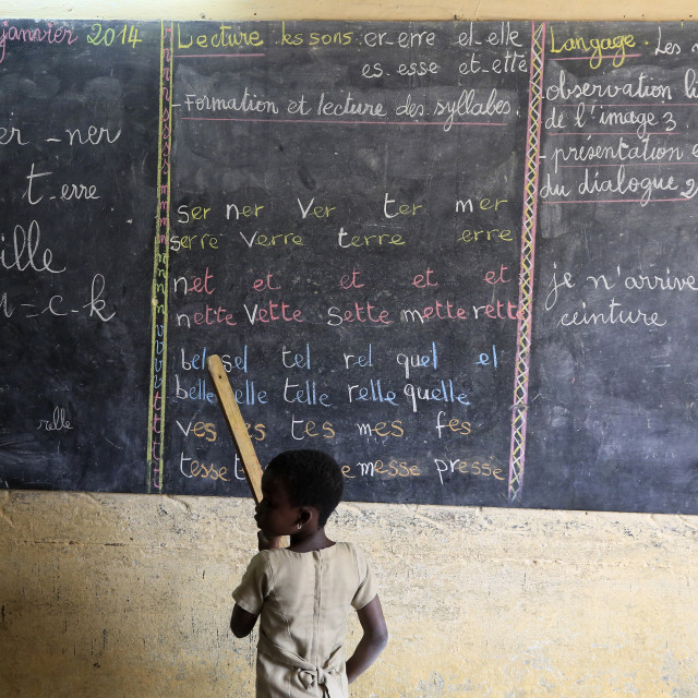 """African primary school. Pupil at the blackboard."" stock image"