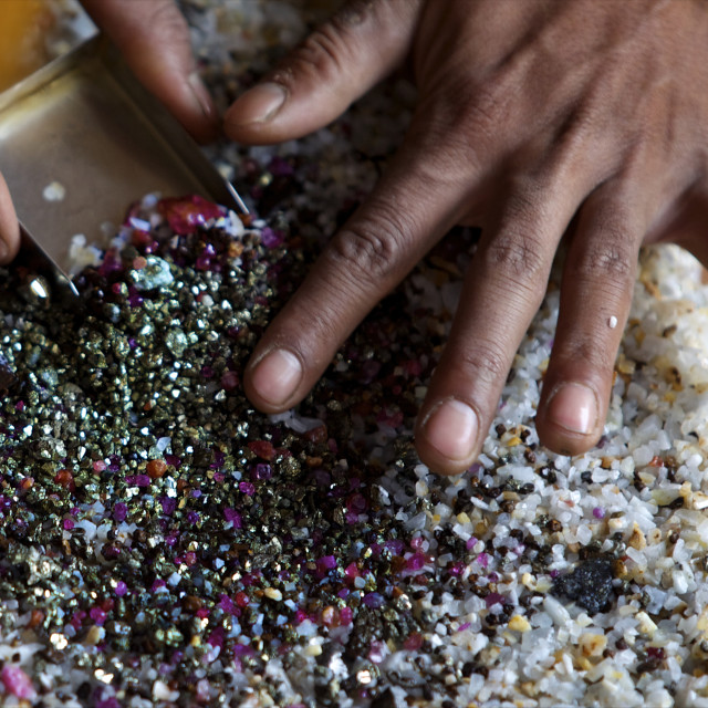 """""""After bashing the sand, the ruby stones concentrate naturally in the middle..."""" stock image"""