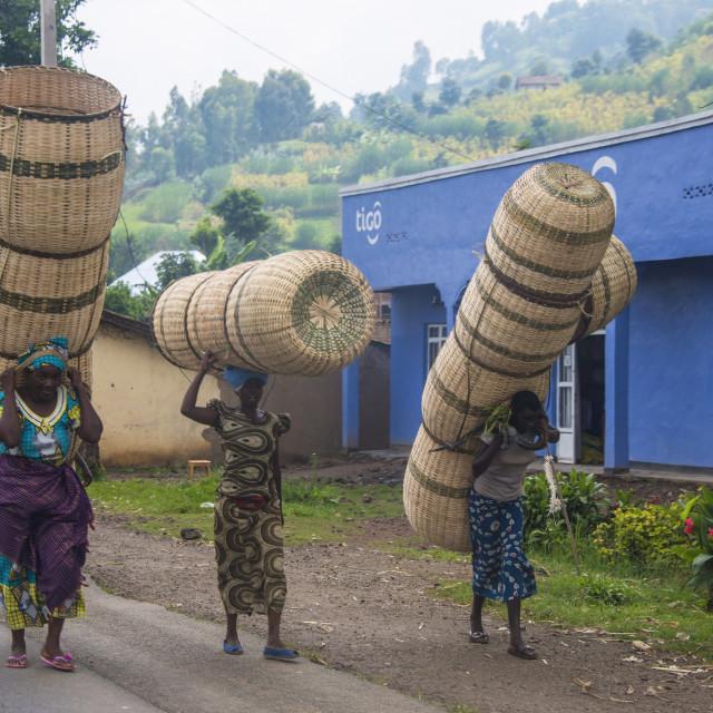"""""""Women carrying giant baskets, Rwanda, Africa"""" stock image"""