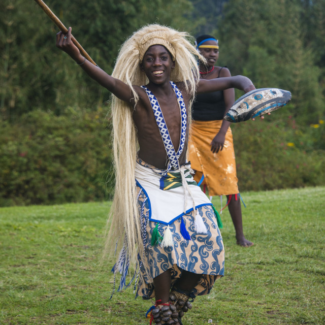 """Man carrying a wig and a spear at a ceremony of former poachers, in the..."" stock image"